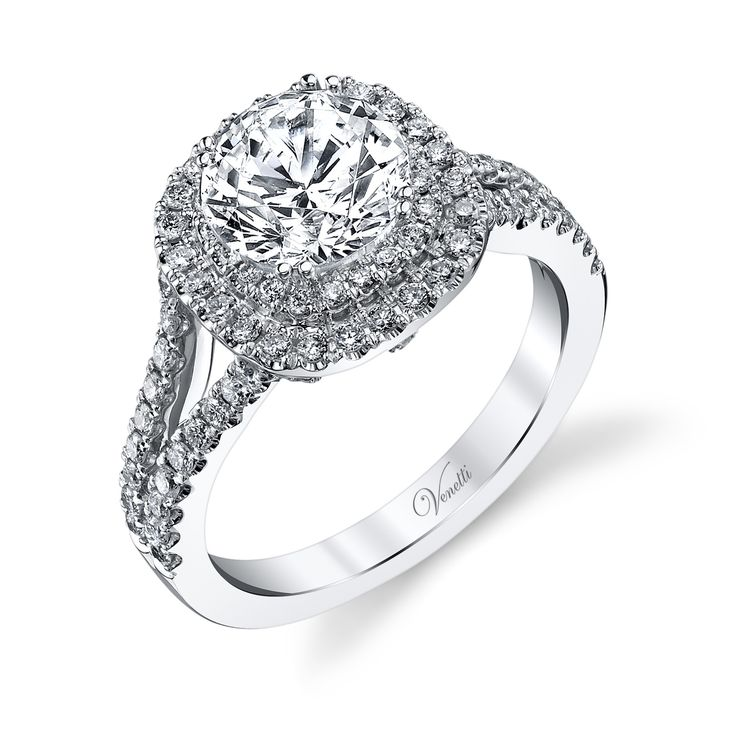 This double halo ring is gorgeous! A exciting play on the original halo design, adding more diamonds and a bigger look. This double halo ring is made in 14k white gold and features a elegant split sha