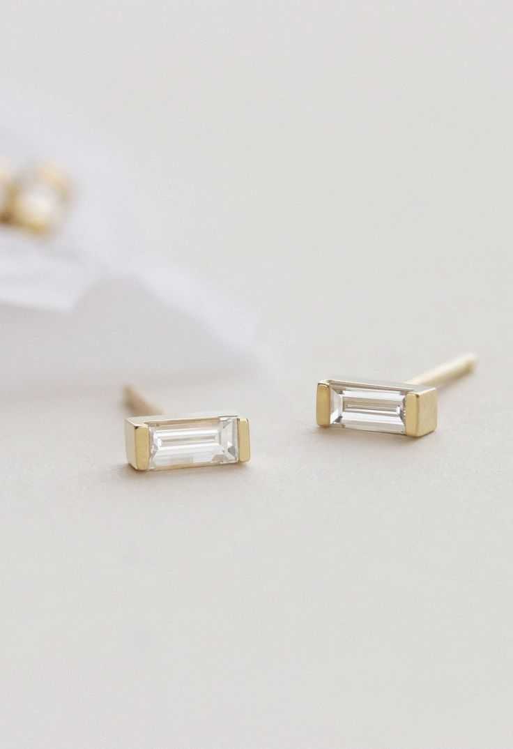 As effortlessly chic as a casual summer in Paris, these studs are our go to for an elevated, everyday look. Set in 14k gold channel settings, these baguette diamond earrings are unassuming, but don't