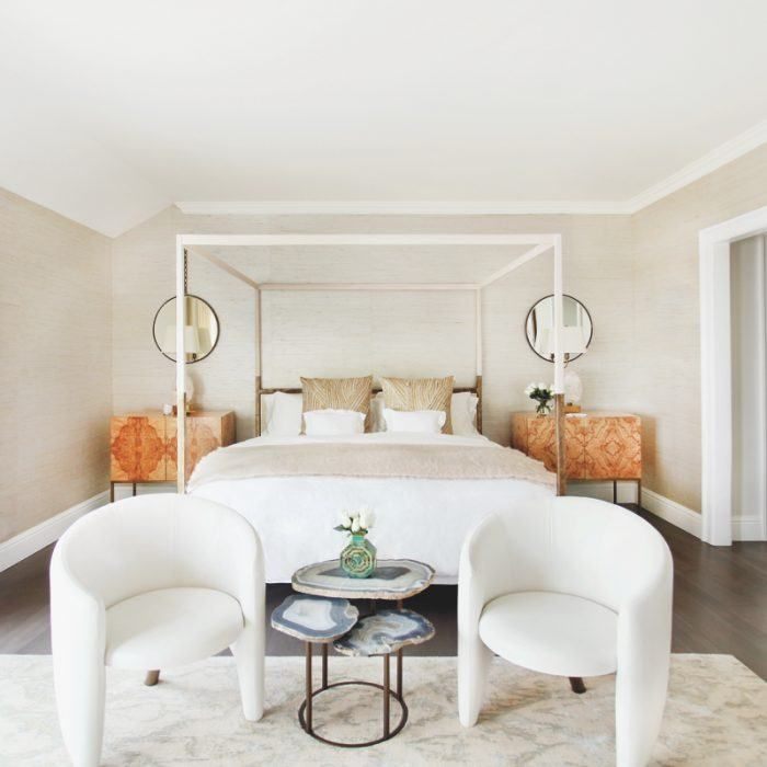 A personalized master suite with a custom wood-and-brass canopy bed from Uhuru Design.