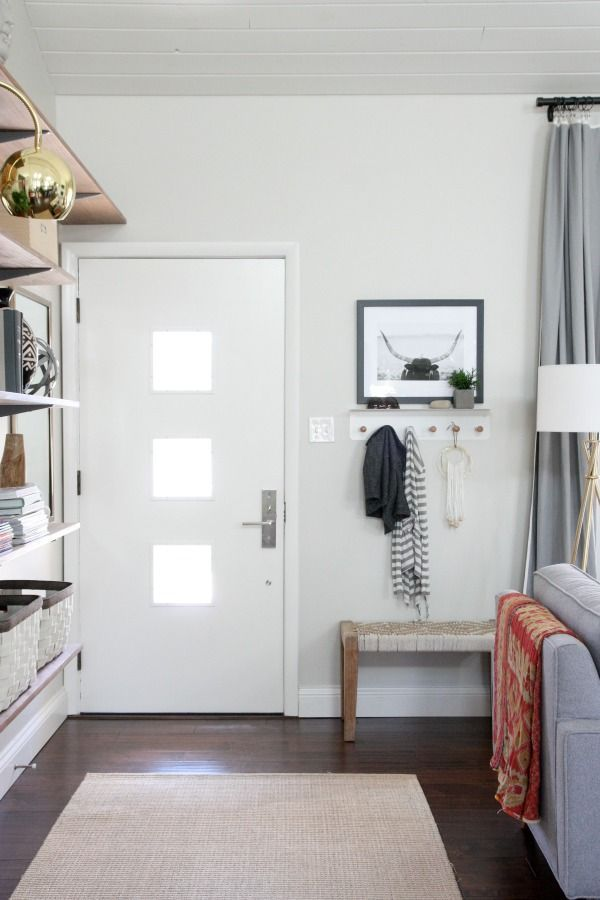 As long as you've got a place to tie your shoes and hang your coat, even the tiniest entryway will feel complete.  See more at House Tweaking »   - CountryLiving.com