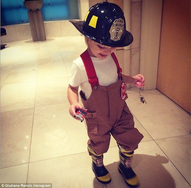 Decked out: The toddler was recently treated to a trip to the Chicago Fire Station for his second birthday