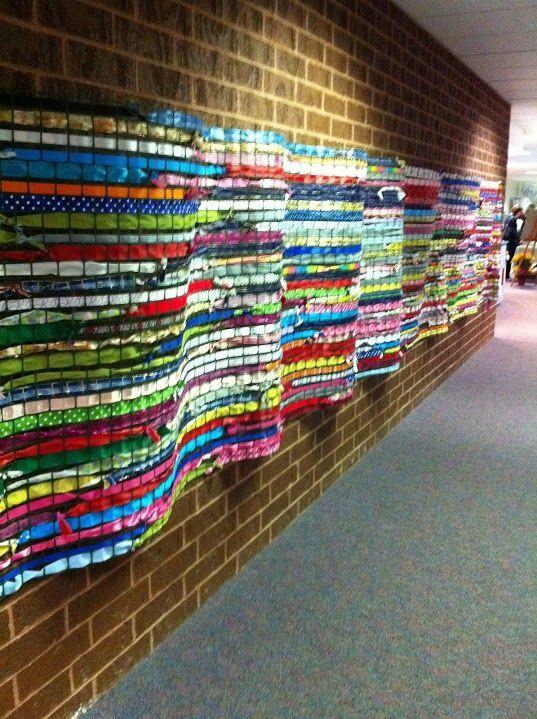 woah! plastic chicken wire and weaving...hallway display
