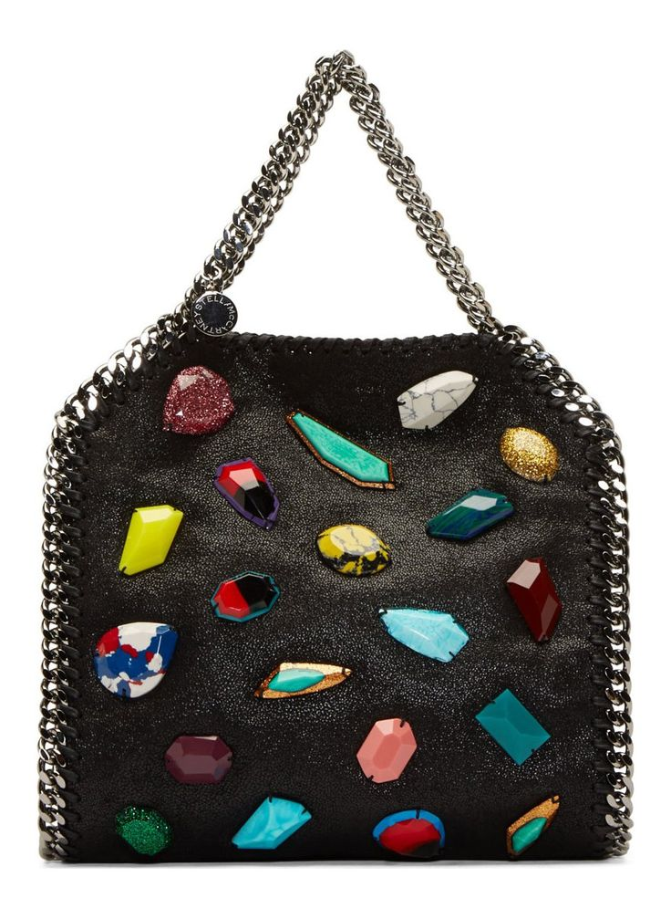 Black Grained Multi Gem Mini Bella Tote BY Stella McCartney. Textured faux-suede tote bag in black. Multicolor gem stone appliqué at bag face. Silver-tone hardware. Curb chain trim, shoulder strap, and carry handles. Logo medallion at carry handle base. Magnetic press-stud closure at bag throat. Zip pocket at interior. Logo-printed lining. Tonal stitching.  http://www.zocko.com/z/JG9yq