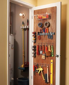 STORAGE & LAUNDRY ROOM. Screw 3/4-in. plywood to the back of a door to provide a solid mounting base for screw hooks, baskets or other storage accessories....good idea for my laundry room