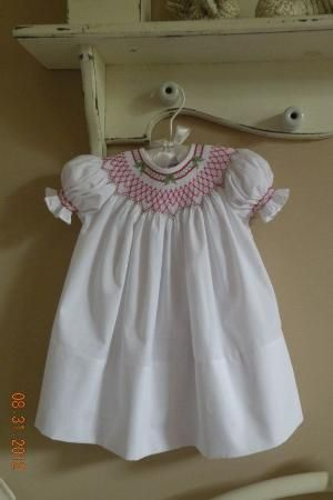 Hand Smocked Christmas Dress                        Sizes Newborn- 24 months $65 by courtney