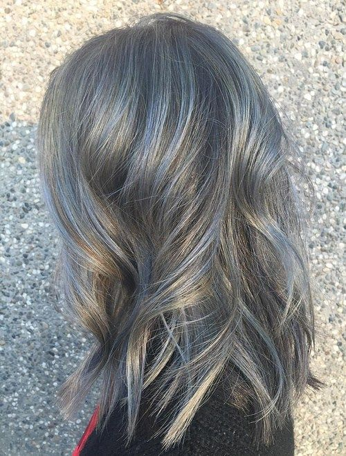 Medium Wavy Gray Balayage Hair Neutral Gray  Light blue strands spreading out over salt and pepper hair would be stunning on any occasion and in any setting. One of the benefits of the gray hair trend is how it works for a neutral base color that can take on other more pronounced hues.