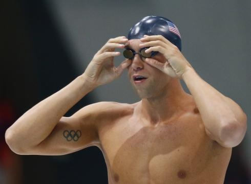 Matt Grevers adjusts his goggles before the men's 100 backstroke semifinals during the London Olympics on Sunday.