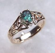 celtic knots and emeralds...love it with a Marquis garnet