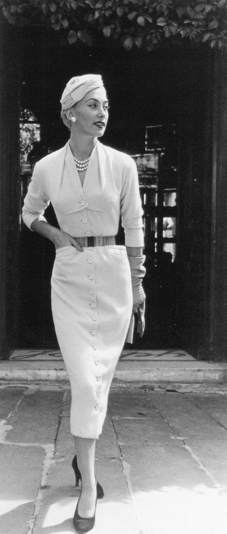 Geneviève in white cashmere button-through dress by Pierre Balmain, photo by Willy Maywald, Paris, 1953