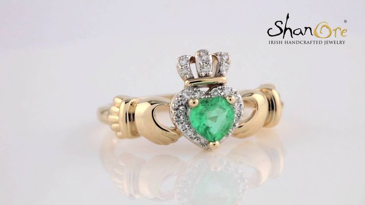 Yellow Gold Claddagh engagement ring set with heart cut Emerald and pave set Diamonds.