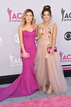 Maddie Marlow (left) and Taylor 'Tae' Dye (right) of music group Maddie & Tae attend the 52nd Academ... - John Shearer /WireImage
