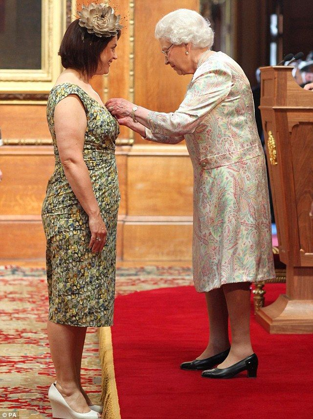 Ruth Jones, here receiving her honour from the Queen, described her MBE as the 'icing on the cake' of her varied career 18 June 2014