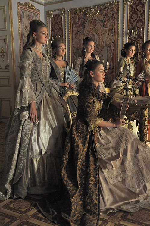 Ladies at the ball, watching Cinderella win the heart of the prince.