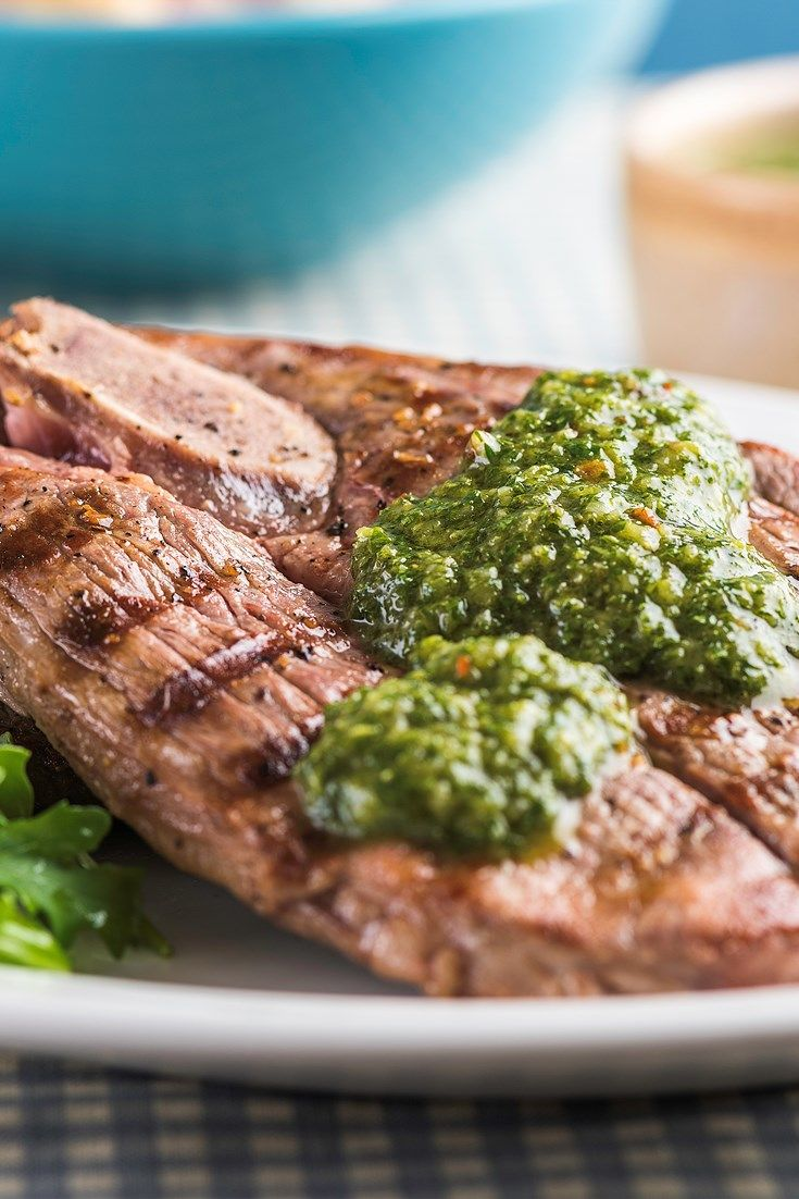 Russell Brown's chargrilled lamb leg steak recipe is served with a simple chimichurri sauce and warm potato salad.