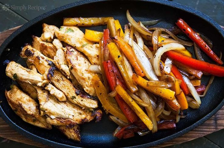The BEST chicken fajitas! Marinated chicken breasts seared quickly and served with seared onions and bell peppers, and flour tortillas. On SimplyRecipes.com