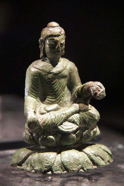 fuckyeahvikingsandcelts:  The Buddha from Helgö Island on Flickr. This 6th century figurine from India was found, along with an irish crozier and a ladle from the Eastern Mediterranean, was found in a wealthy Viking farm on Helö Island in lake Mälaren, Sweden. Historiska Museet, Stockholm, 2014