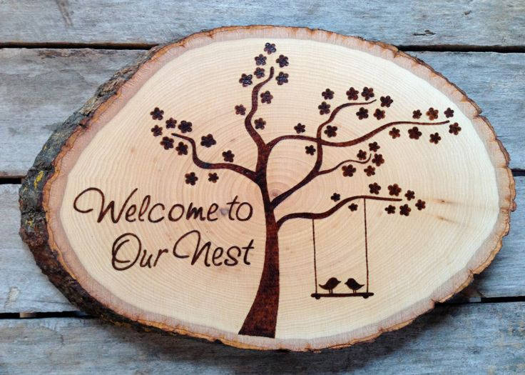 Welcome to our Nest, Wood burned sign with blossom tree and love birds, unique housewarming gift, newlyweds. $65.00, via Etsy.