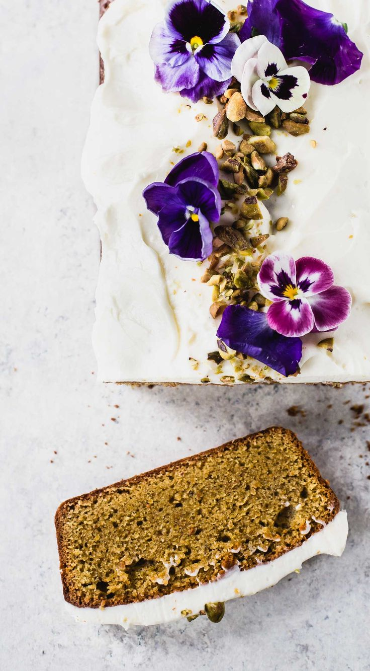 This buttery, Cardamom Pistachio Cake is made with teff flour & topped with dreamy clouds of cream cheese frosting. Gluten-free recipe, baked in a loaf pan.