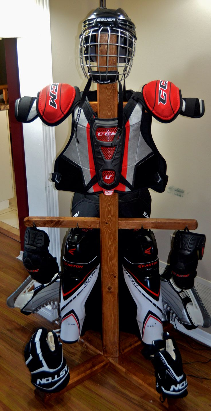 """Hockey equipment stand. 60"""" tall.  30"""" wide. Dowels to support gloves and skates. Air your equipment out, and look good doing it."""