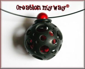How to make a hollow polymer clay ball with holes in it. Also shows how to make a caged ball out of polymer.