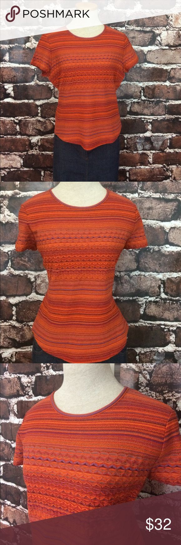 """Missoni short sleeve tee chevron red orange purple Gorgeous short sleeve top in classic vibrant colors. Shades of orange, red, purple, and periwinkle in horizontal stripes and a chevron pattern across chest. Rounded neckline. Rounded bottom hem. Fabric has a bit of stretch. Excellent condition. Fabric and size tag has been removed. I️ estimate it as a small. My mannequin is an xs. Use measurements for sizing. 22"""" length at longest. Armpit to armpit is 19"""". Could fit a petite possibly. M by…"""