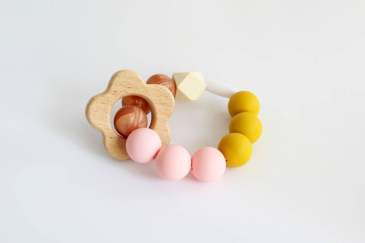 Teething Bracelet. Bpa free silicone beaded bracelet with natural wooden flower ring teether ring by Mustard & Mint by mustardandmintuk on Etsy https://www.etsy.com/uk/listing/509241514/teething-bracelet-bpa-free-silicone