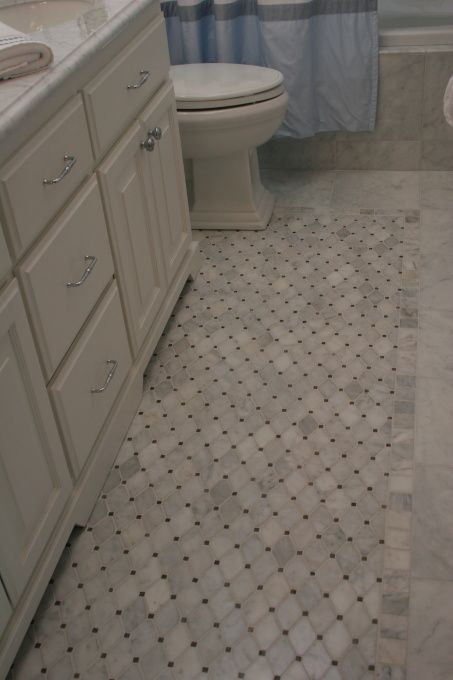 like these floors tile inlay in small master bathroom