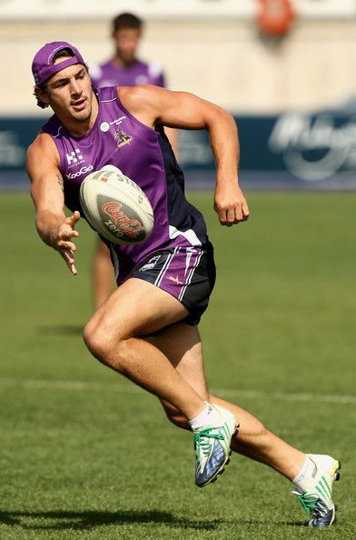 Billy Slater of the Storm passes the ball during a Melbourne Storm NRL training session held at Visy Park on February 18, 2009 in Melbourne, Australia. (Photo by Quinn Rooney/Getty Images) *** Local Caption *** Billy Slater