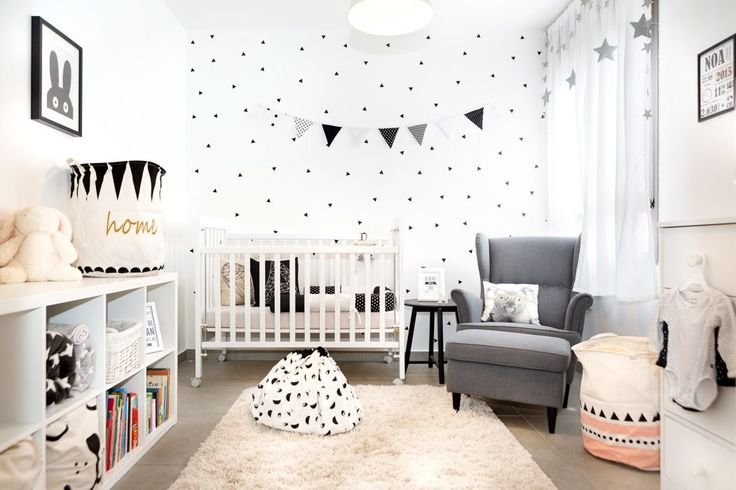 A gender neutral, monochrome nursery with just a hint of color to brighten things up.