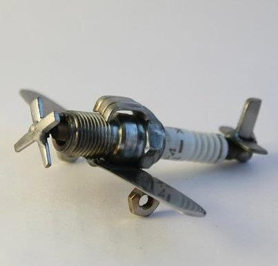 Cute plane made from an old sparkplug