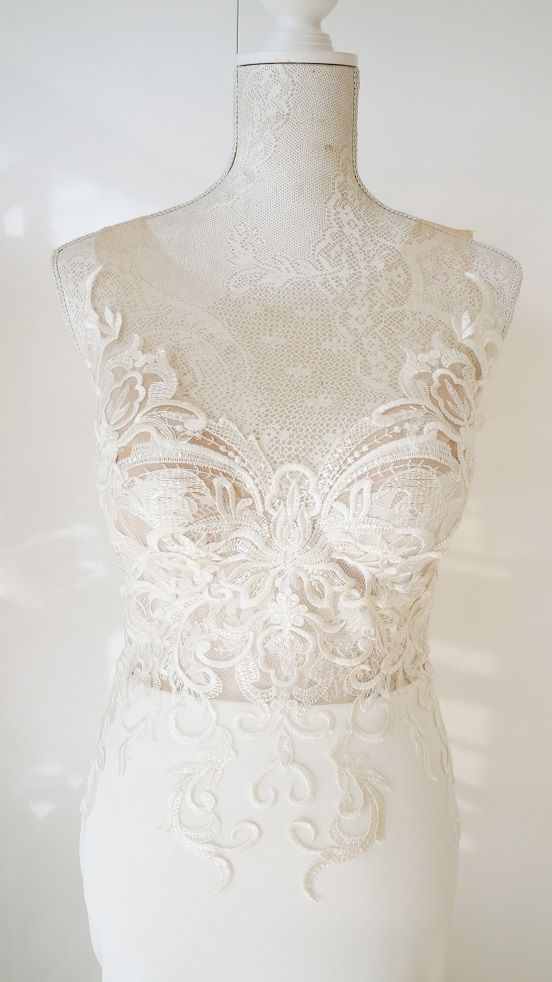 Scuba wedding dress with lace bodice and illusion back.