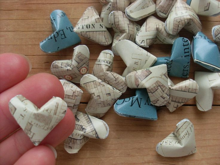 Origami Hearts from a Greenwich Village Literary Landmarks Poster, set of 24.. $7.95, via Etsy (I found out how to make these, tho: http://www.youtube.com/watch?v=Dg-U_fckT2Q)