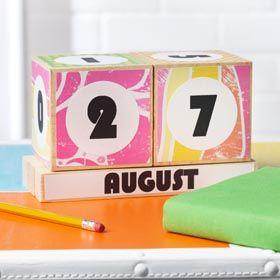 Create a fun, wood block calendar using wooden cubes, scrapbook paper and Mod Podge Matte.