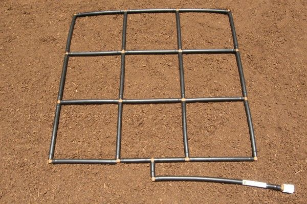 The Garden Grid watering system - 3x3. A pre-assembled irrigation system and planting grid in one! by GardenInMinutes.com