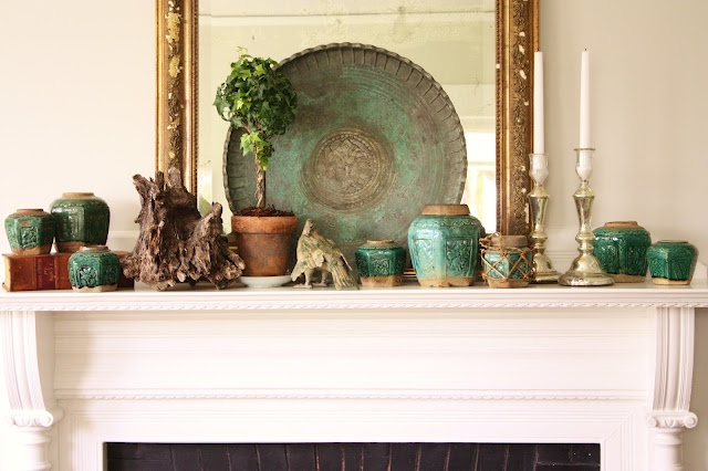 "Green ""spring"" mantle arrangement with Chinese ginger jars and Indian copper tray"