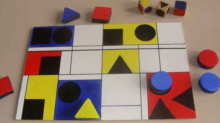 Mondriaanspel! Gooi, afhankelijk van ontwikkelingsniveau, 1, twee of drie dobbelstenen die kleur, vorm en achtergrond bepalen. (idee en uitwerking Ineke Vanderstraeten)