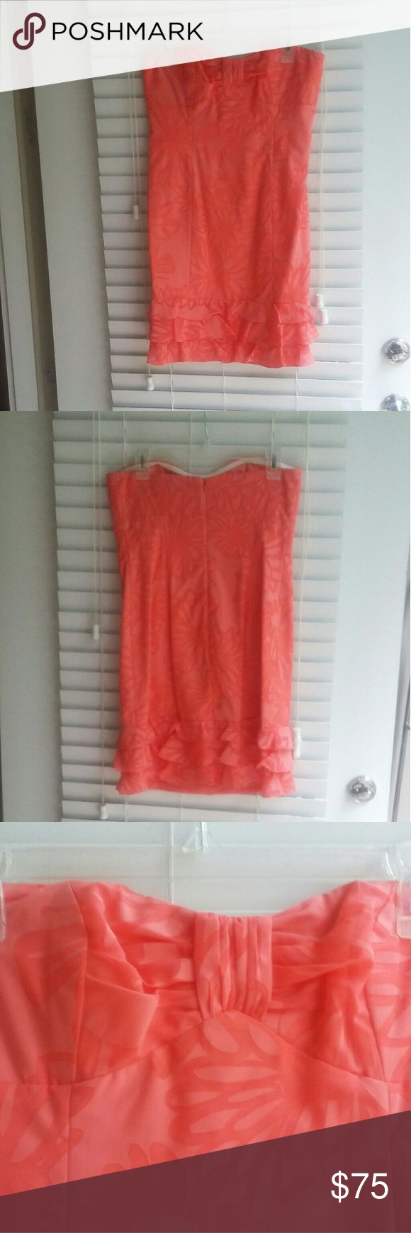 Lily Pulitzer Coral Sundress Adorable strapless sundress with mermaid neckline and ruffles at the bottom. Color is a peachy coral - perfect for spring and summer. Worn 1 time. Lilly Pulitzer Dresses Strapless