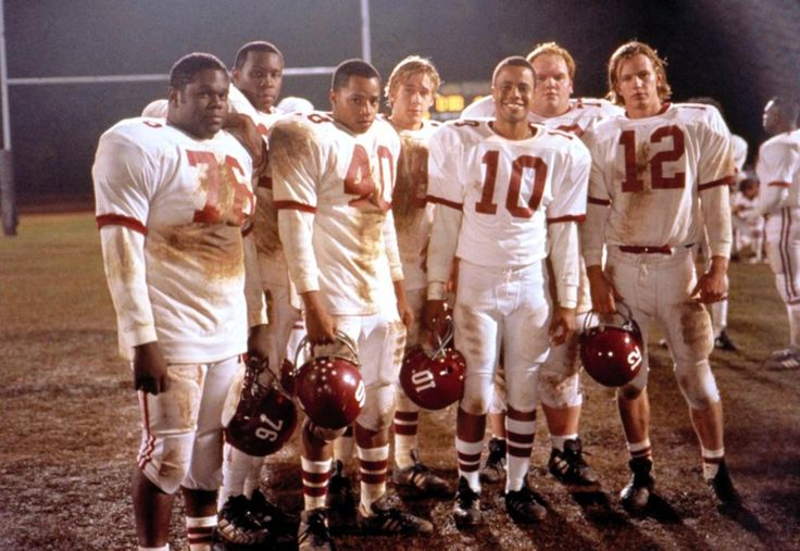"""Remember The Titans"" movie still, 2000.  L to R: Earl C. Poitier, Wood Harris, Donald Faison, Ryan Gosling, David Jefferson, Jr., Ethan Suplee, Kip Pardue."