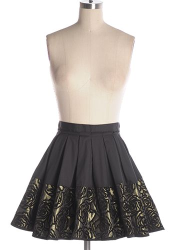 Make a statement in this beautiful baroque-inspired black and gold party skirt with rose pattern and pleats. Side zipper. 95% cotton, 5% polyester Not stretchy Not lined Hand wash cold; hang dry Indie, Retro, Party, Vintage, Plus Size, Convertible, Cocktail Dresses in Canada NEW: Gold Dust Skirt -