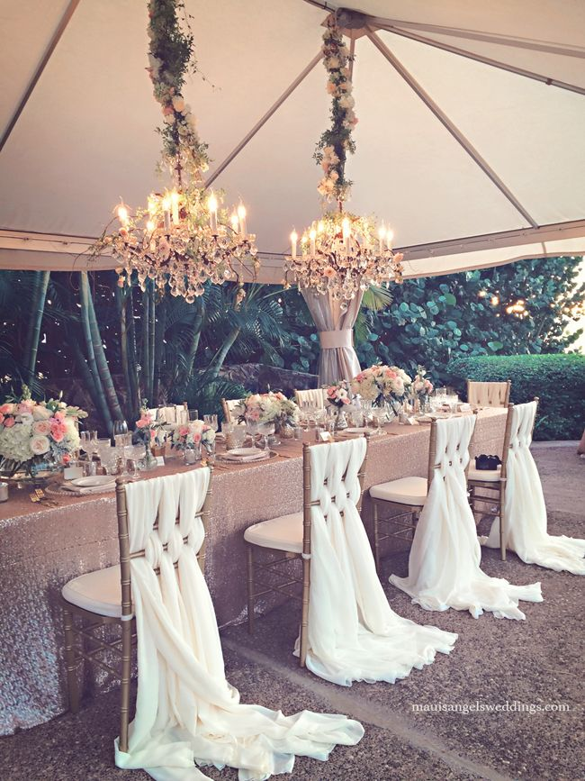 Romantic wedding reception with floral and crystal