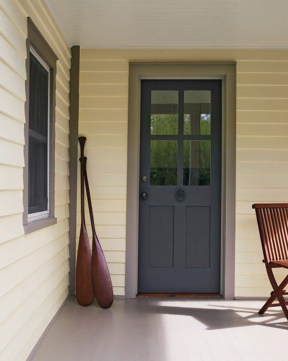 To create beautiful entrances on a budget, Paul Ochs worked with a door manufacturer to modify one of their stock designs. The double-glazed glass-paneled doors let in light in an energy-efficient way.