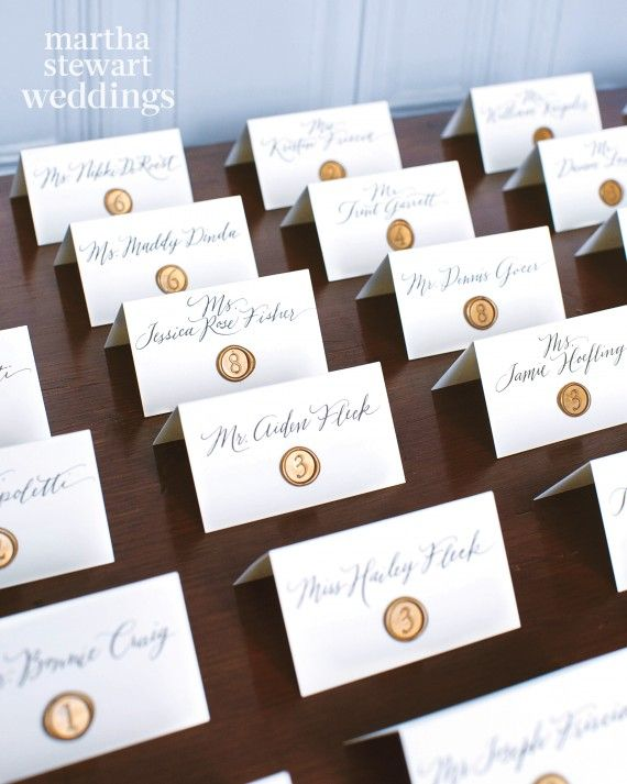 Guests found their seats with the help of calligraphed escort cards adorned with wax seals.