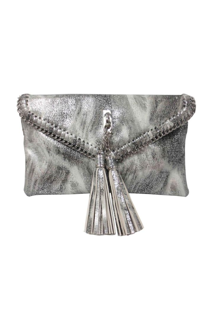 """Silver metallic clutch that includes attachable crossbody strap. Magnetic flap opening with tassels. Interior includes two zippered compartments.     Measurements: 5.5""""H 9.5""""L 9.5""""W Silver Metallic Clutch  by Sondra Roberts. Bags - Clutches - Evening New York"""