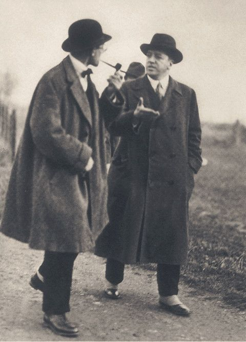 Mies van der Rohe walks with Le Corbusier at the Weißenhof estate, 1927.  The Charnel-House
