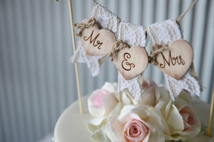 Rustic wedding cake topper captured by Ateia Photography & Video