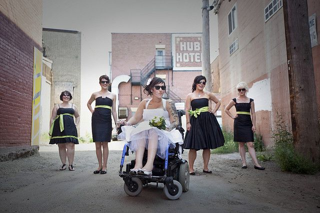 How to find a wheelchair-friendly wedding dress | @offbeatbride - I love this photo idea with everyone wearing sunglasses and attendants being farther back so their heads line up with the bride in the wheelchair