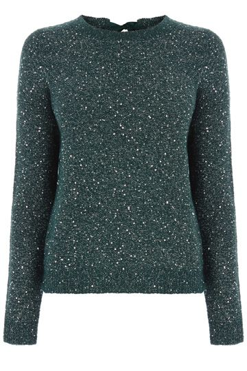 The cutest jumper around, our sequin bow back jumper has the sweetest details. We love the comfy crew neck knit that has a subtle sequin shimmer and the ribbon tie fastening at the nape of the neck. This is the sweetest way to make the classic jumper and jeans combination that little bit sparklier this season.