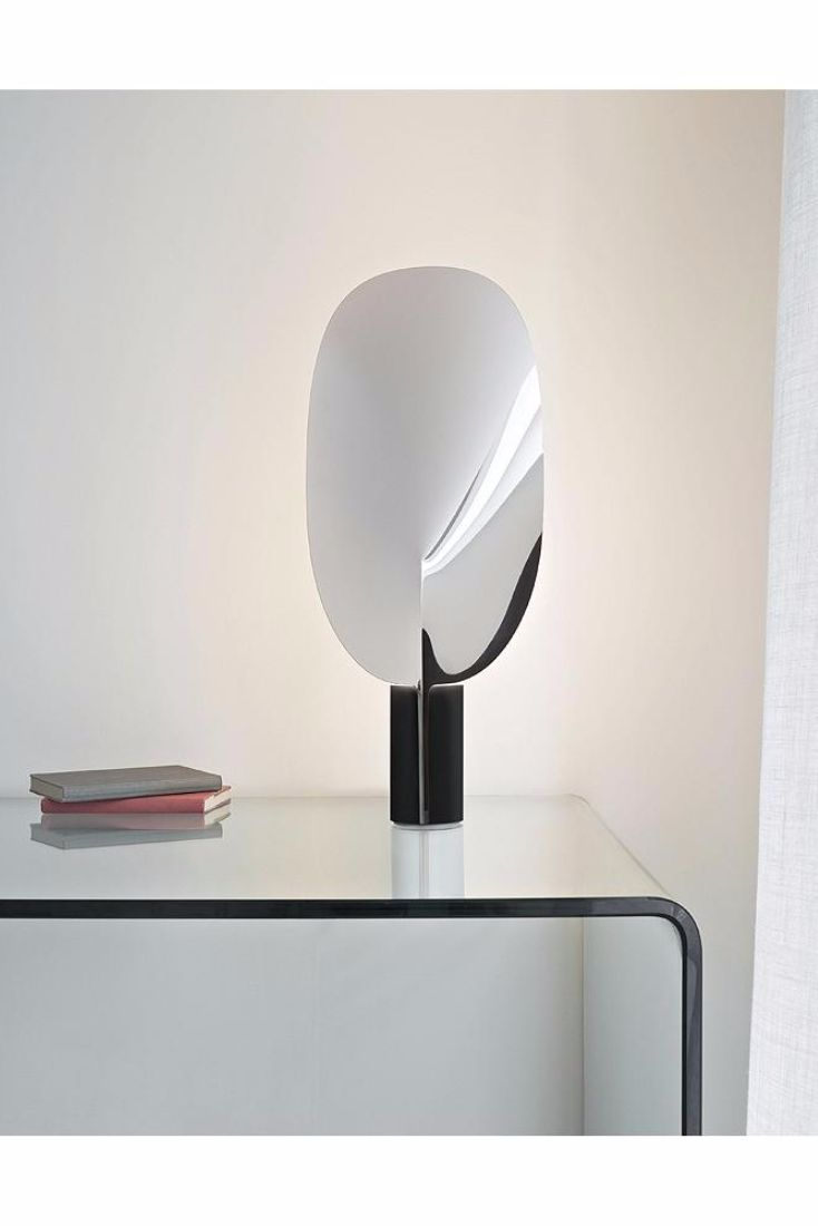 10 best flos extra t images on pinterest table lamps glass the serena table lamp by flos recalls the simple beauty of nature featuring a sheared geotapseo Choice Image