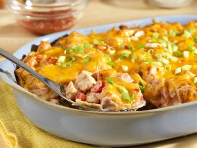 """King Ranch Casserole This """"king"""" of all casseroles gets a punch of great flavor from picante sauce, chili powder and green onions.  It's a flavorful way to use leftover chicken or turkey that will have your family coming back for more! My family loves it!"""