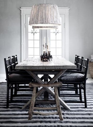 tine k lampe, rustic dining table with black chairs and grafic rug,